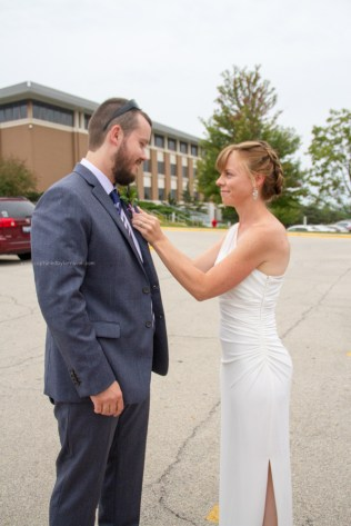Bride helps with flowers to groom, Courthouse