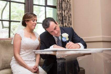 Bride groom sign ketubah, Chicago Wedding