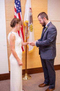 Wedding ceremony ring exchange, courthouse