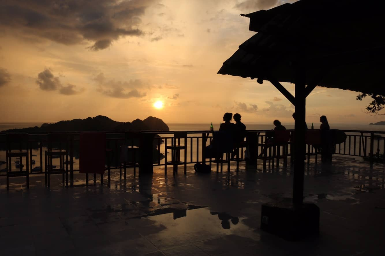 People enjoying the sunset on a rooftop terrace