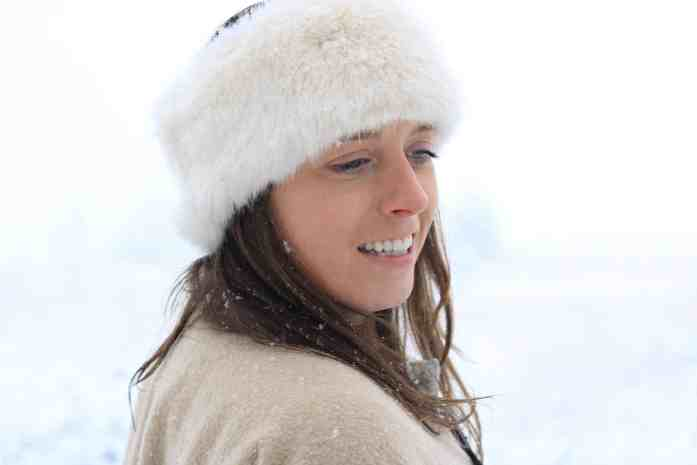 Snowy portrait of a girl with a furry hair band on
