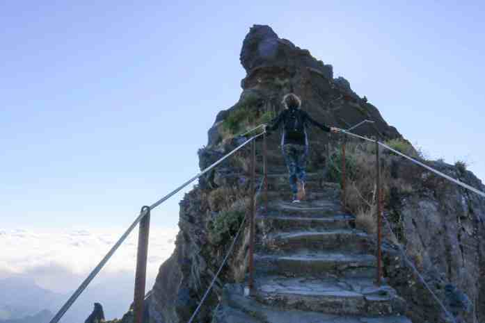 Girl climbing the steps of a mountain path Madeira