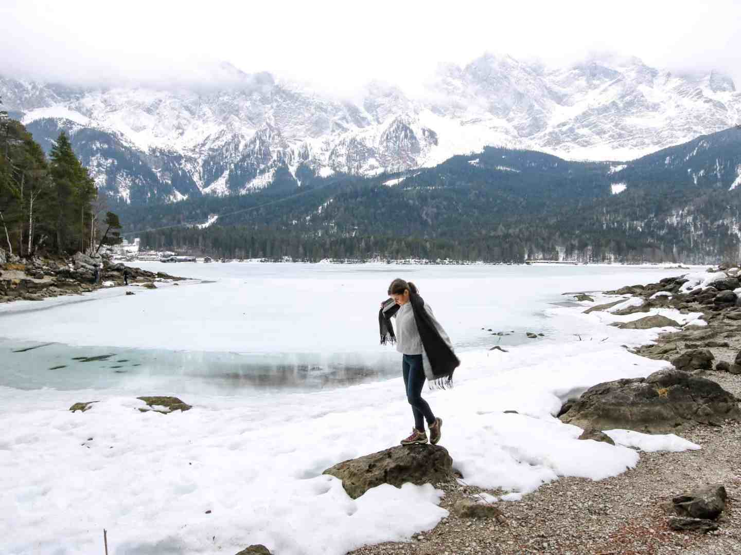 Girl in front of a frozen lake Eibsee