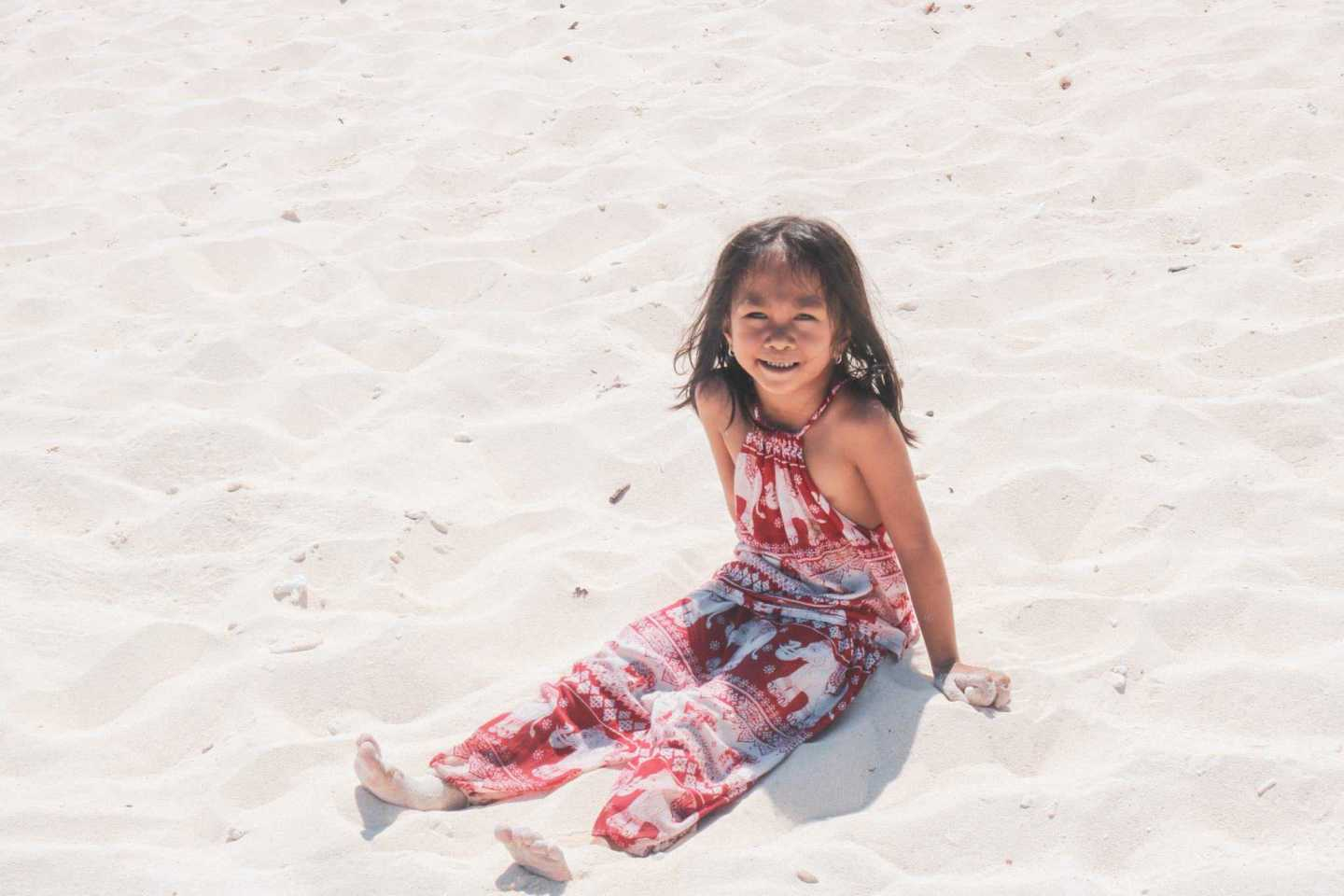 Little girl from the Philippines sitting in the sand Tao expedition