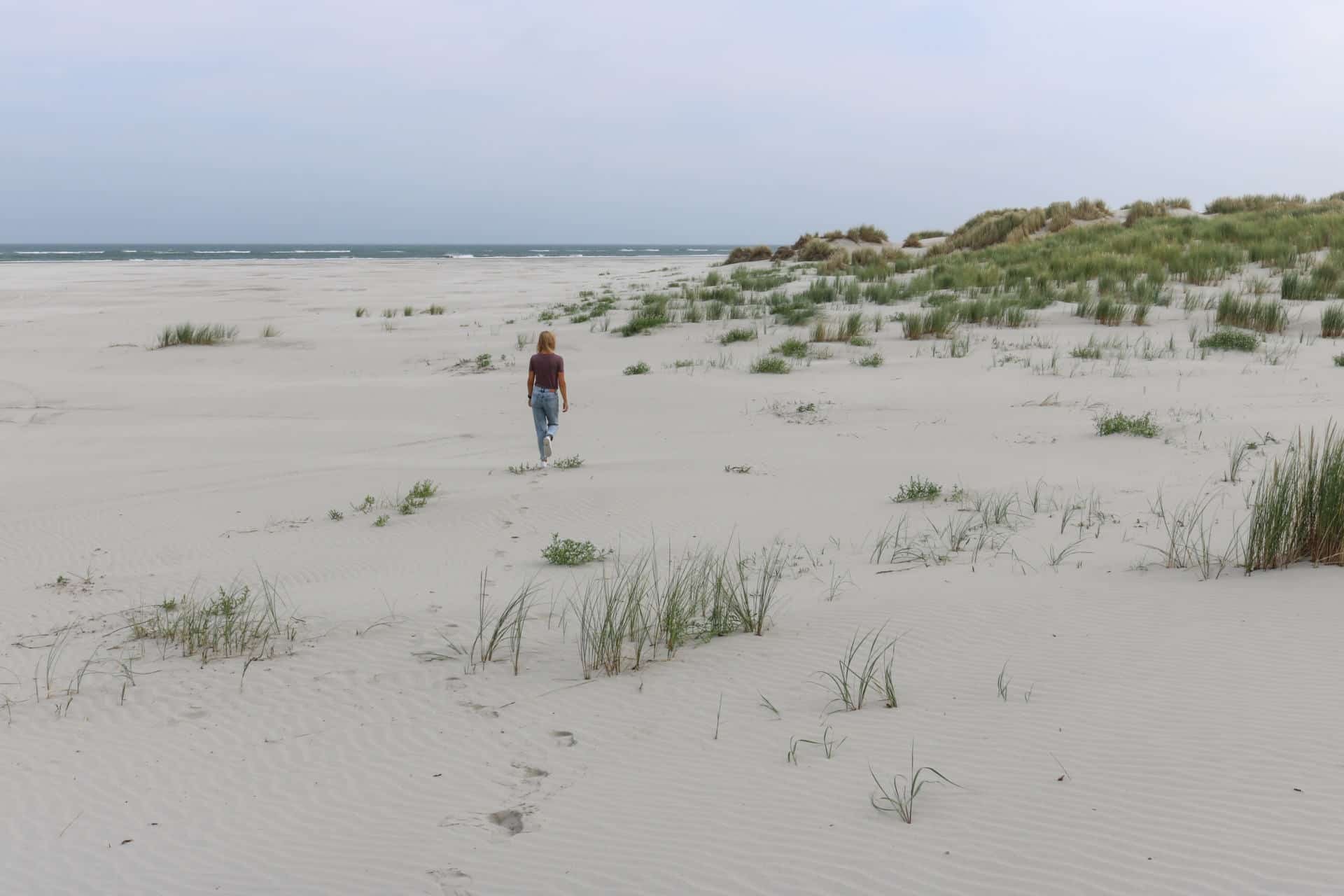 Girl walking on a beach in Schiermonnikoog