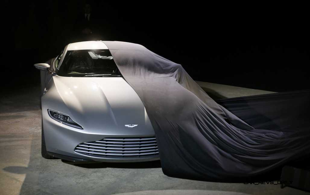"""An Aston Martin DB10 car is unveiled on stage during an event to mark the start of production for the new James Bond film """"Spectre"""" at Pinewood Studios"""