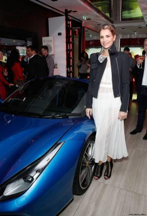 Vogue Williams beside the Ferrari 488 Spider at the UK launch at the Watches of Switzerland store London