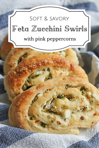 Salty feta, juicy zucchini and spicy pink peppercorns baked into a buttery soft savory swirl. Easy savory treat or appetizer recipe packed with flavor.