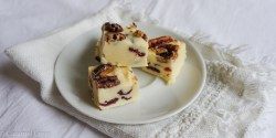 Easy white chocolate fudge recipe with juicy cranberries and caramelized pecans. Perfect for an edible gift!