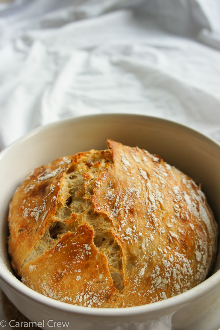 Easy no-knead bread recipe with a crunchy crust and a subtly sweet and moist inside. Homemade bakery style bread with so little effort - this will become your new favorite time-saving recipe for bread!
