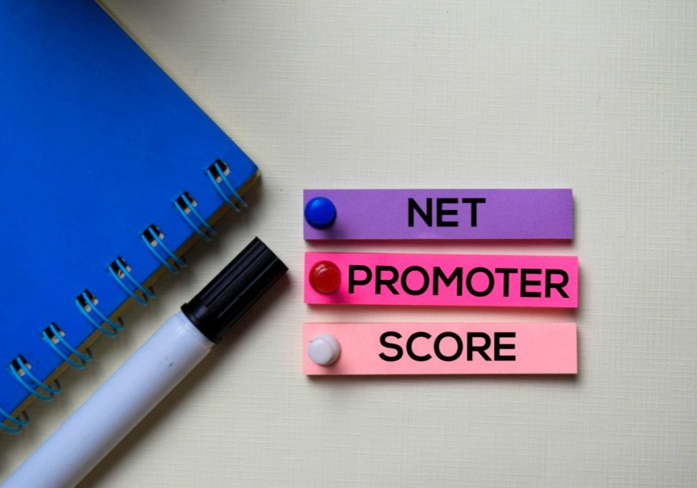 Net Promoter Score - NPS text on sticky notes isolated on office desk