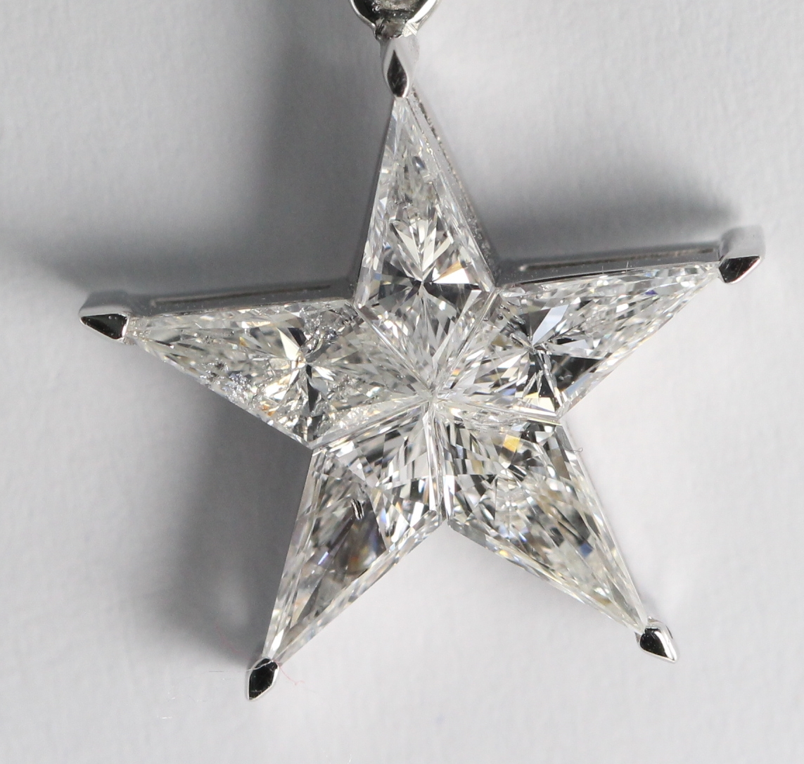 What Is An Invisible Setting Star Shaped Diamond Pendant