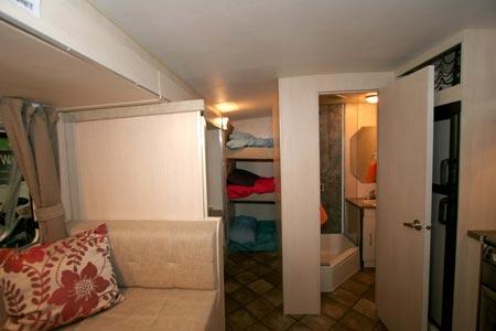 Rear triple bunks and bathroom