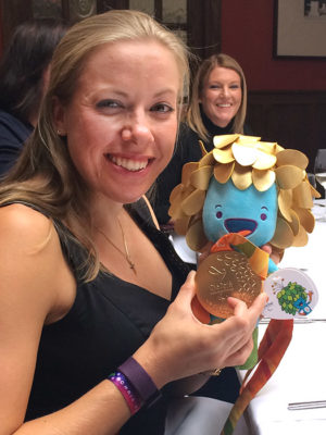 Hannah Cockroft with Rio Paralympics Gold medal and mascot (Louise in background)