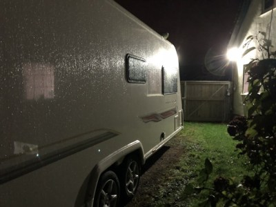 Caravan under security light