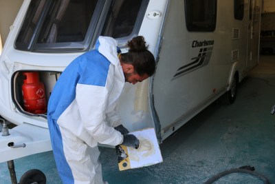 repairing the damage on a caravan
