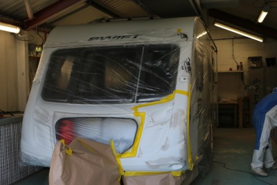 repairing a damaged caravan -wrapping it