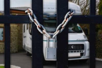 Motorhome behind locked gates