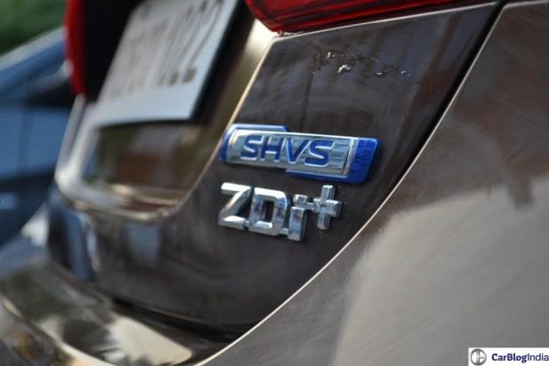 Diesel, Petrol Price in India - Delhi, Mumbai Diesel and Petrol Prices maruti-ciaz-SHVS-diesel-hybrid-review-pics-badge