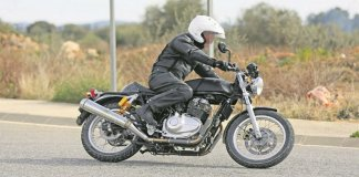 royal enfield 750cc bike images side profile action photo