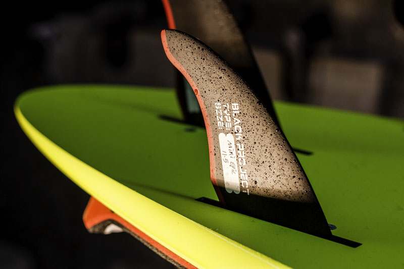 CA thruster fins on a board