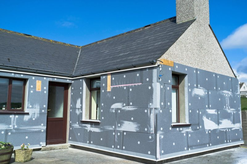 Wall insulation attached to external walls of bungalow