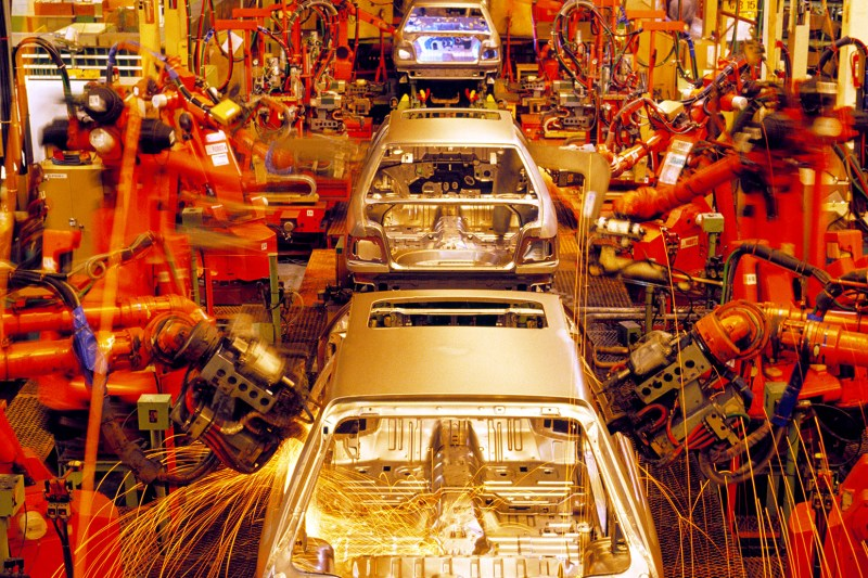 Assembly line of automobiles. Credit: Pat Behnke / Alamy Stock Photo. A9E069