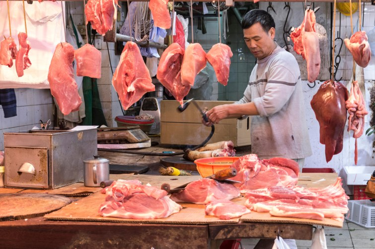 A stall selling meat on the street in Hong Kong.