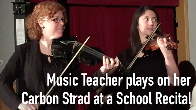 Music teacher plays at school recital.