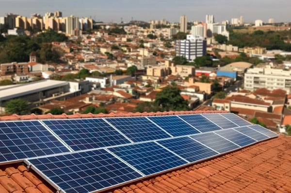 Brazil city with solar panels in foreground