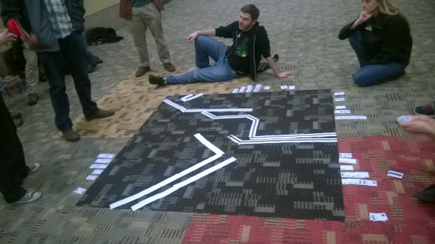 Playtesting Lazer Ryderz on the floor out in the hallway with Tino Martino, Dan Raphael, and Jordan Martin