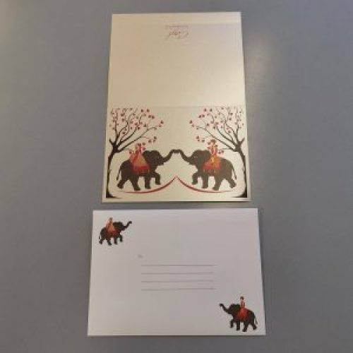 A5 landscape orientation invitation card with an Indian couple on elephants - outside view. A matching white envelope with the same couple and elephants design.