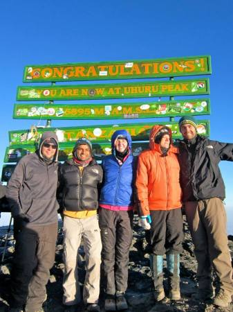 Laura Lee, center, stands at the summit of Mt. Kilimanjaro. SUBMITTED