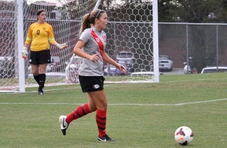 Hannah Miller kicks soccer ball