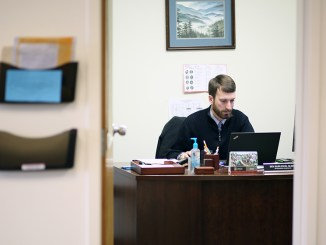 Ben Burleson, programming coordinator of the Vocatio Center for Life Calling and Career, works in his office. | Photo by Amanda Rohde, staff photographer