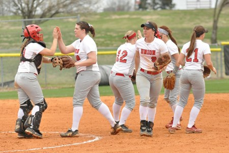Members of the softball team high five one another after earning three outs during a home game at Fesmire Field earlier in the season. |Submitted photo by Union Sports Information