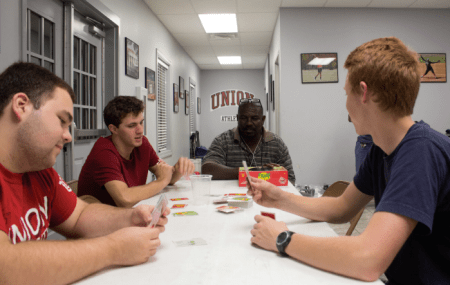 Paul Johnson plays card games with students. | Photo by Caleb Lay