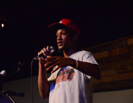Emerick Lester, freshman athletic training, performs original songs at Barefoots Joe Open Mic. | Photo by Gretchen Foels, staff photographer