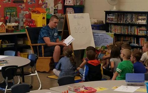 8th Grade Shares Books with Kindergarten and First Graders