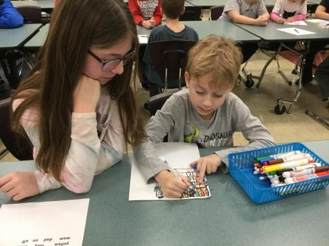 Kindergarten and Fifth Grade Collaborate on Book for Boomer