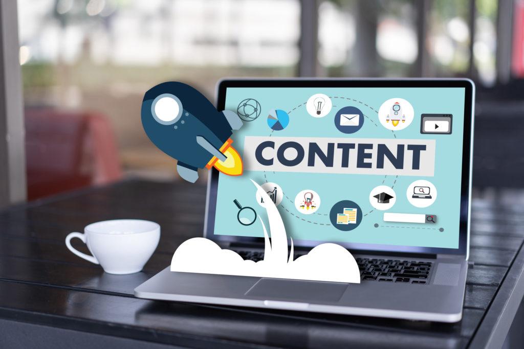Header for blog. Content marketing on laptop on a desk.