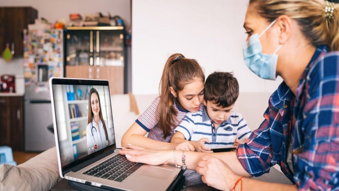 young family using telehealth