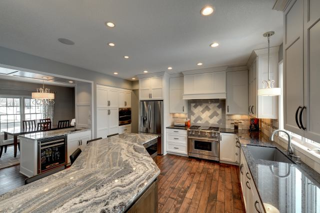 painted cabinets, large island, eat in island