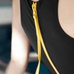 Black with yellow zip