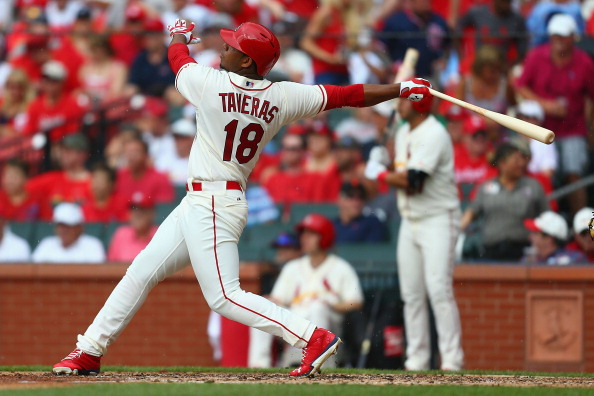 Oscar Taveras of the St. Louis Cardinals hits a solo home run, the first of his career, in the fifth inning against the San Francisco Giants at Busch Stadium on May 31, 2014 in St. Louis, Mo.  (Photo by Dilip Vishwanat/Getty Images)