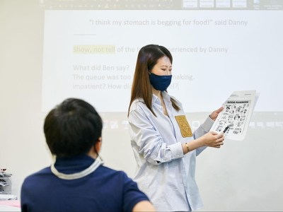 tutor teaching writing course to young student