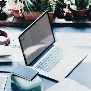 Your study space - Laptop with notebooks