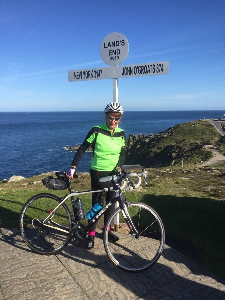 Jacky on her bike at Lands End
