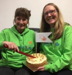 Jacky Massos and Mair Smith with a birthday cake