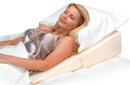 Caregiver positioning aids pillows and cushions for in